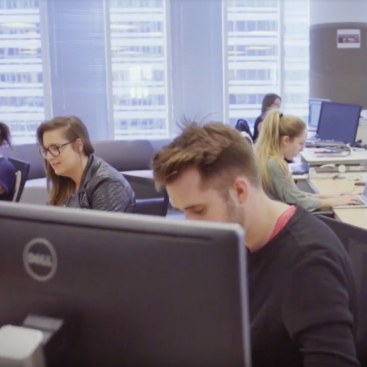 People working in an open concept office